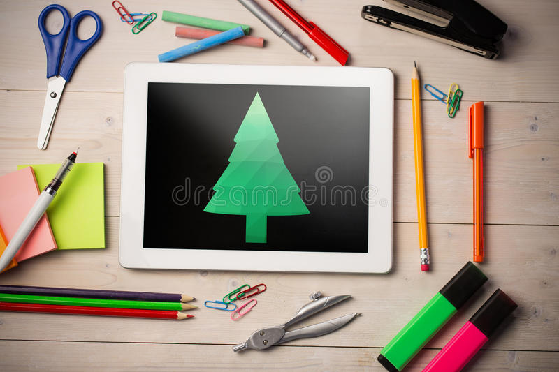 Composite image of digitally generated image of christmas tree. Digitally generated image of Christmas tree against black stock photography