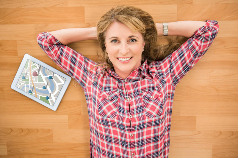 Composite image of digitally generated image of navigation pointers. Digitally generated image of navigation pointers against smiling woman lying on floor next vector illustration