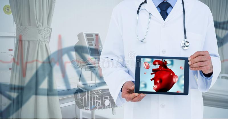 Composite image of doctor showing table with heart. Digital composite of Composite image of doctor showing table with heart stock photos