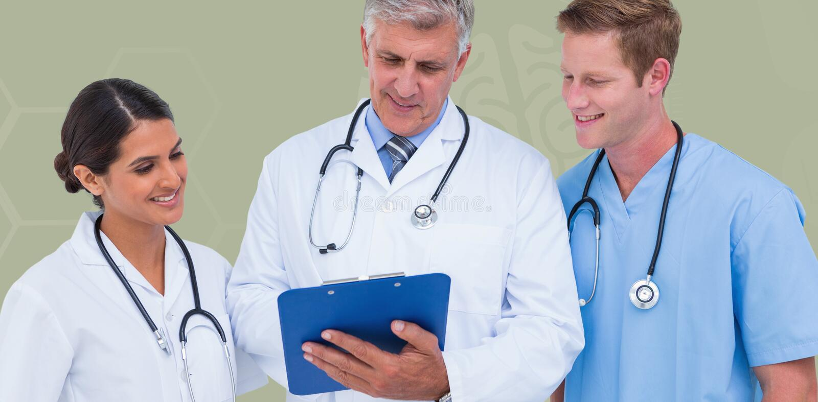 Composite image of doctor working with colleagues while holding writing pad. Doctor working with colleagues while holding writing pad against blue royalty free stock image
