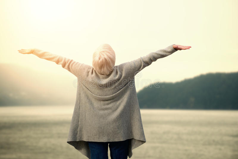 Composite image of elder woman stretching stock image