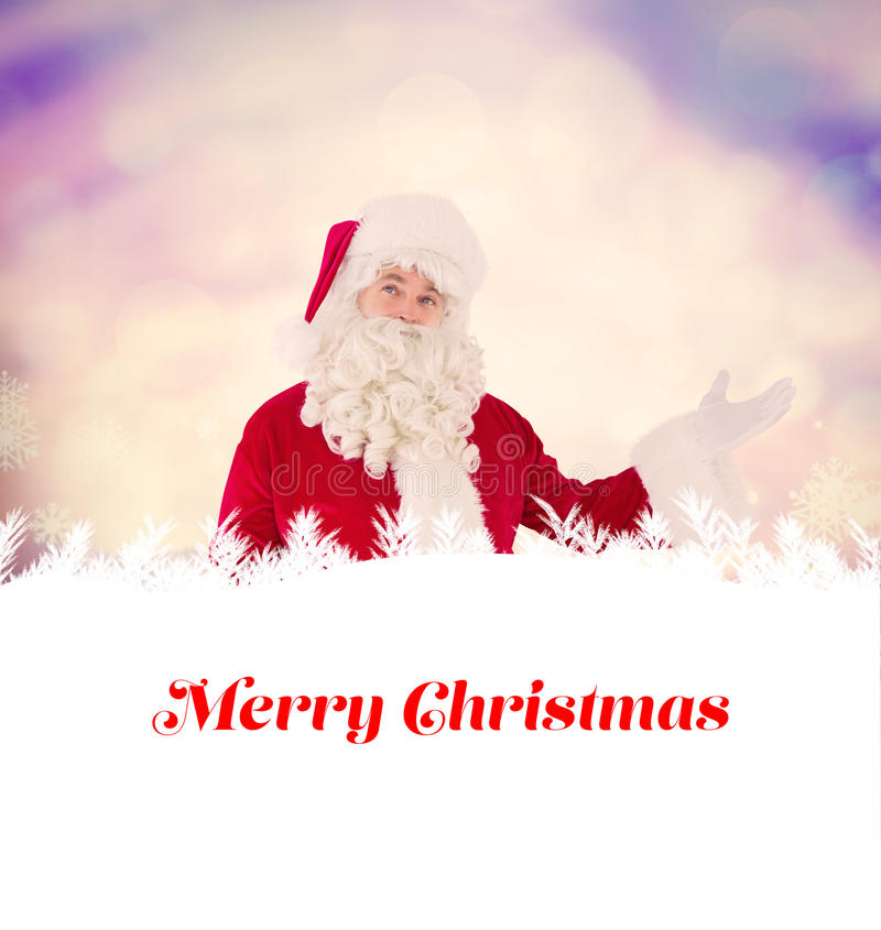 Composite image of father christmas with his hands out royalty free stock photo