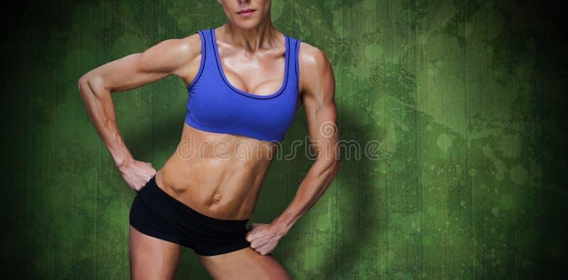 Composite image of female bodybuilder stock photos