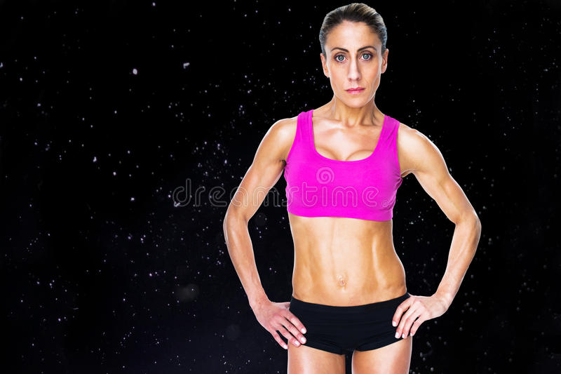 Composite image of female bodybuilder posing with hands on hips looking at camera vector illustration