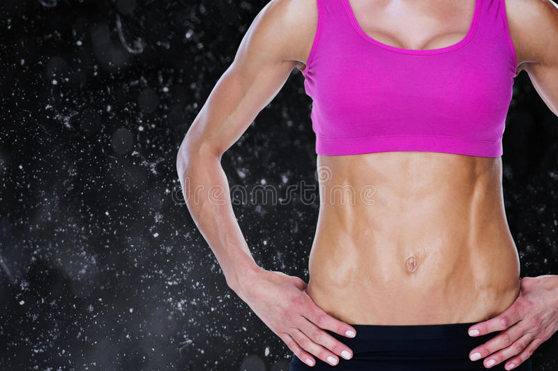 Composite image of female bodybuilder posing with hands on hips mid section vector illustration