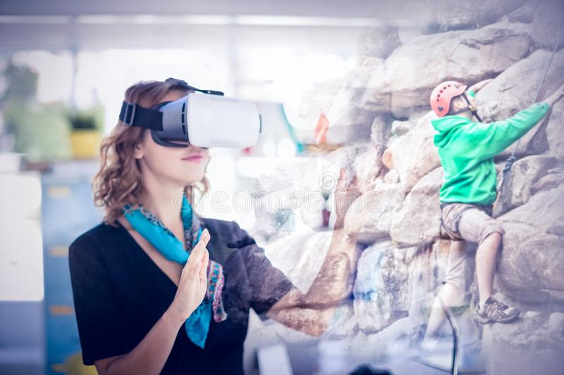 Composite image of female executive wearing virtual reality headset royalty free stock photos