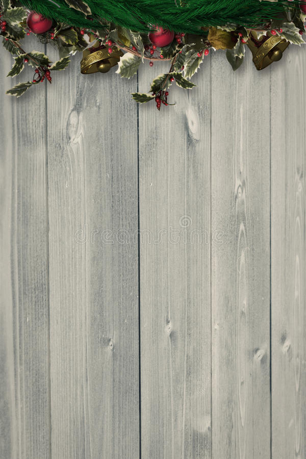 Composite image of festive christmas wreath. Festive christmas wreath against bleached wooden planks background royalty free illustration