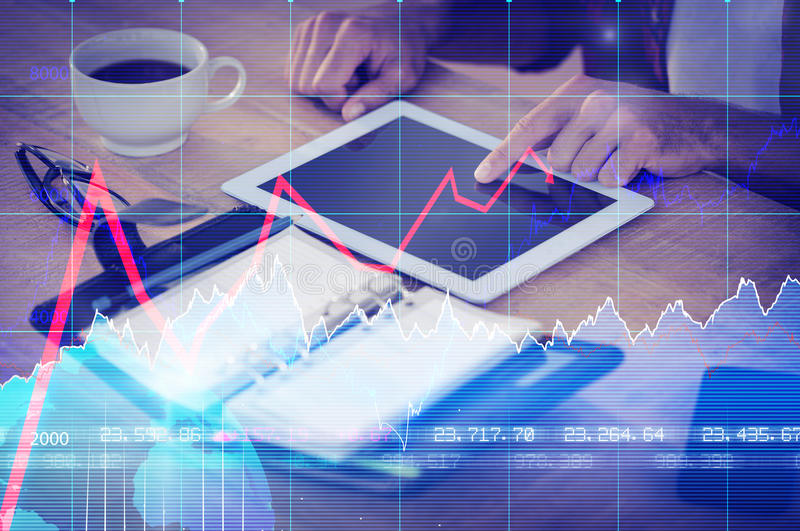 Composite image of financial chart with graph and arrows. Financial chart with graph and arrows against creative businessman using a tablet stock photo