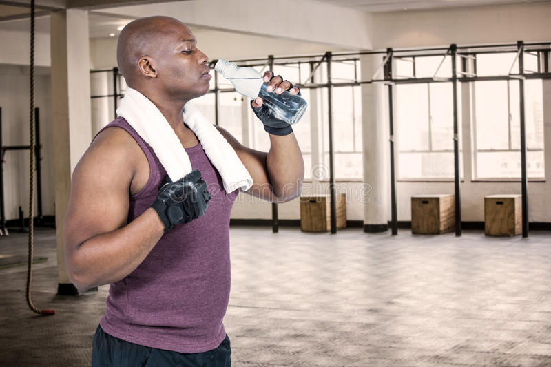 Composite image of fit man exercising with barbell stock photo