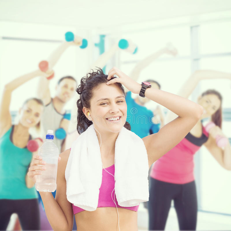 Composite image of fit woman with water royalty free stock image