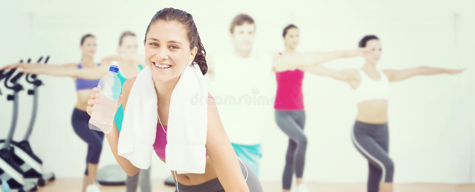 Composite image of fit woman with water stock image