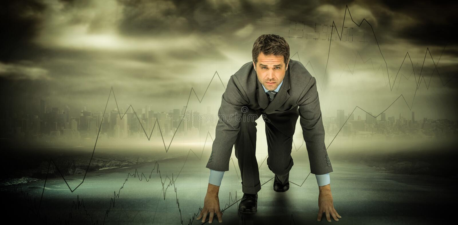 Composite image of focused businessman ready to race stock photos