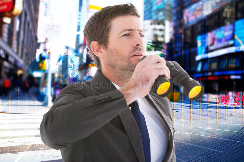 Composite image of focused handsome businessman holding binoculars. Focused handsome businessman holding binoculars against global business graphic in blue royalty free stock image