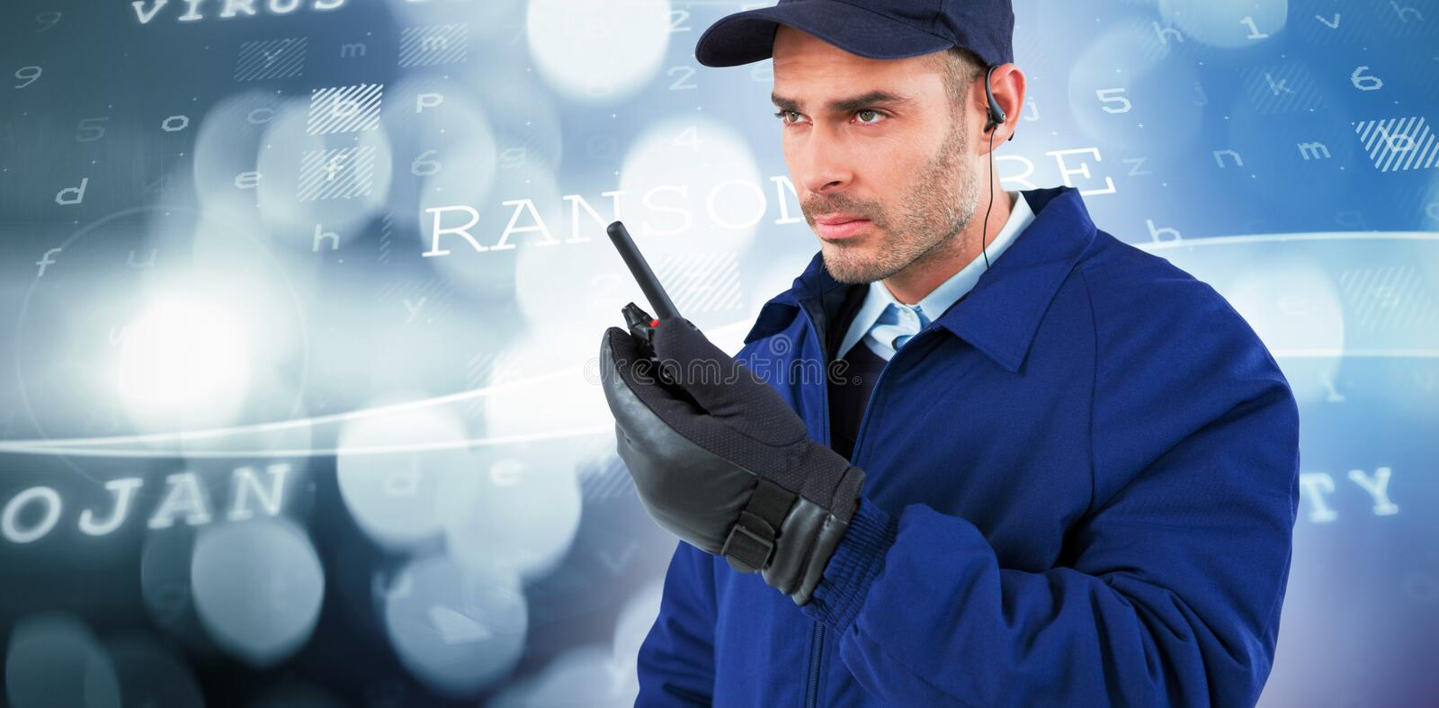 Composite image of focused security officer talking on walkie talkie. Focused security officer talking on walkie talkie against virus background stock image