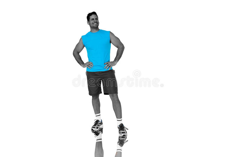 Composite image of full length portrait of a fit young man smiling royalty free stock photo