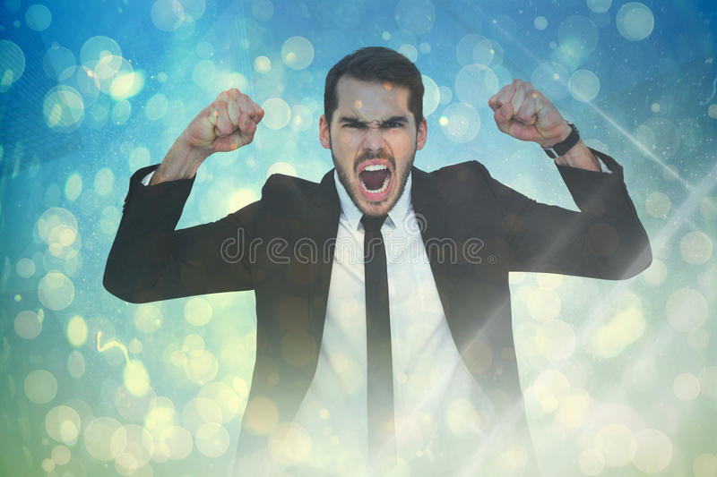 Composite image of furious businessman tensing arms muscle. Furious businessman tensing arms muscle against blue abstract light spot design stock photos