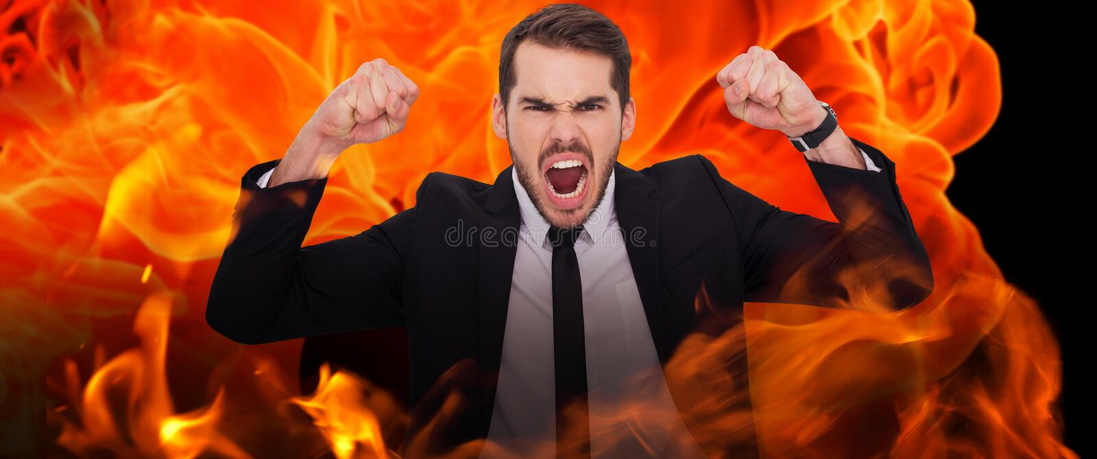 Composite image of furious businessman tensing arms muscle. Furious businessman tensing arms muscle against fire stock images
