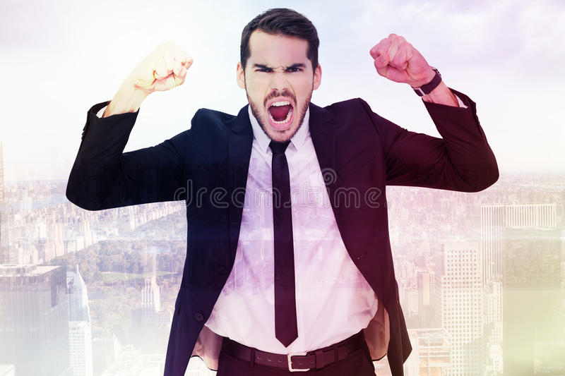 Composite image of furious businessman tensing arms muscle. Furious businessman tensing arms muscle against room with large window looking on city royalty free stock image
