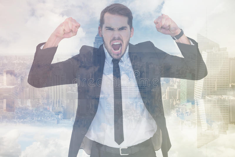 Composite image of furious businessman tensing arms muscle. Furious businessman tensing arms muscle against room with large window looking on city royalty free stock photo