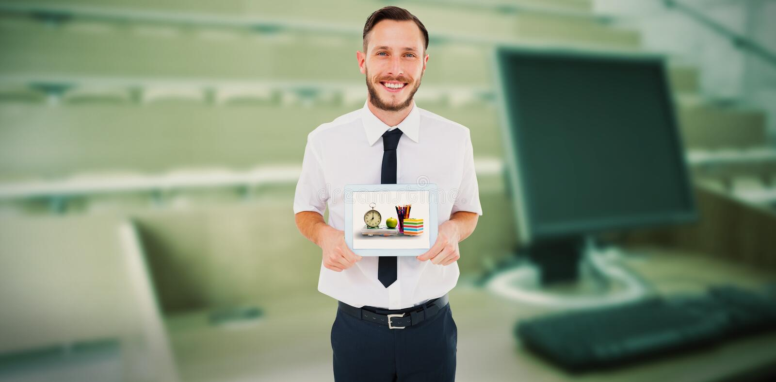 Composite image of geeky businessman showing his tablet pc royalty free stock photography
