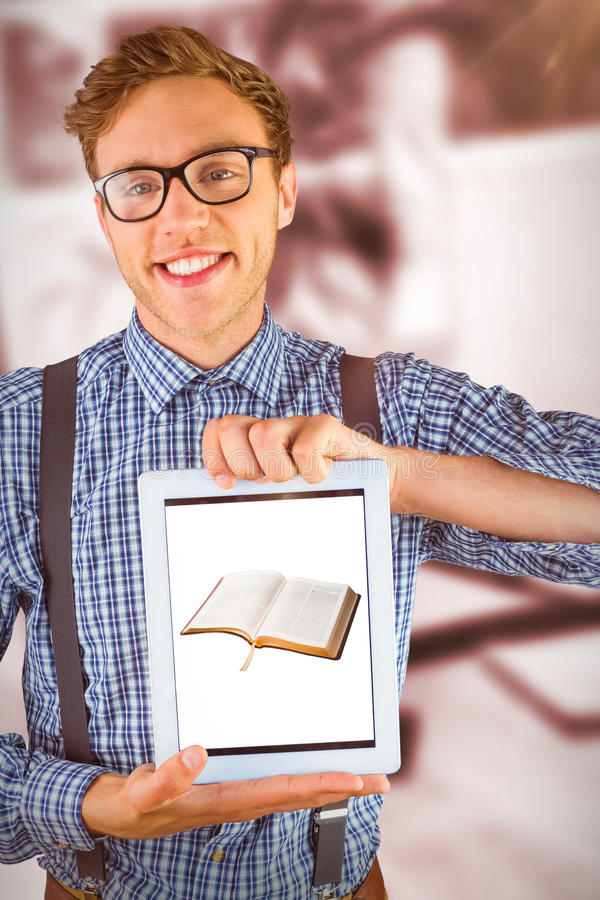 Composite image of geeky businessman showing his tablet pc royalty free stock images