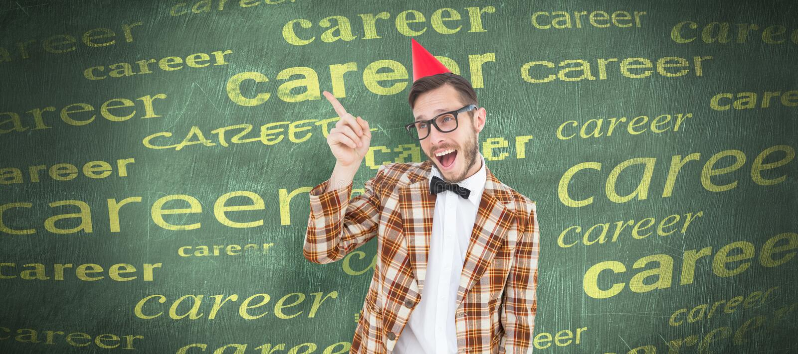 Composite image of geeky hipster in party hat pointing. Geeky hipster in party hat pointing against green chalkboard stock images