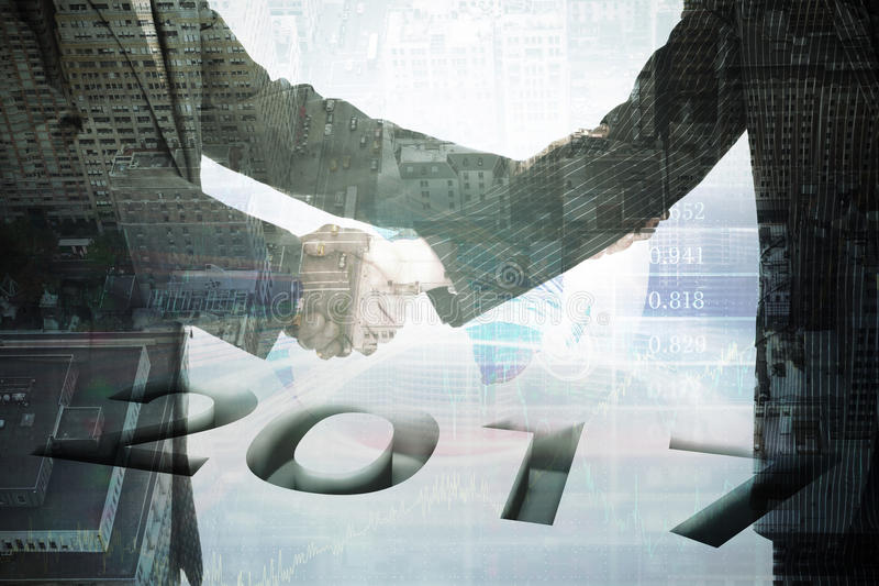 Composite image of 2016 graphic. 2016 graphic against stocks and shares royalty free stock images