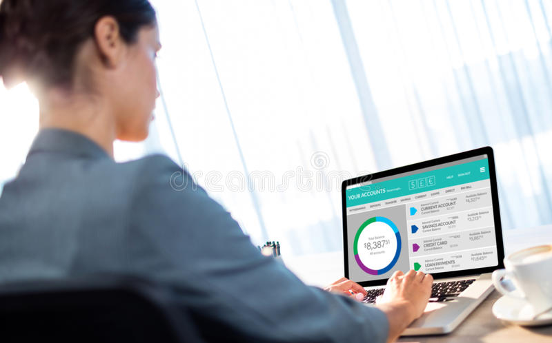 Composite image of graphic image of bank account web site. Graphic image of bank account web site against businesswoman typing on laptop stock photography