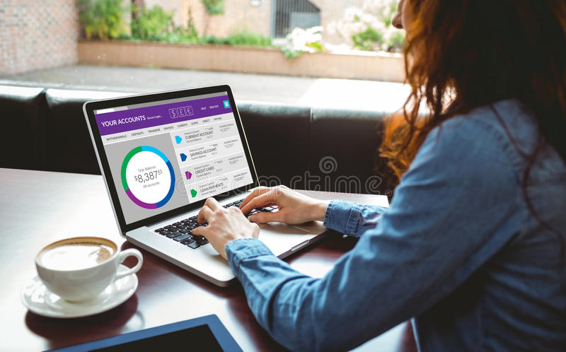 Composite image of graphic image of bank account web site. Graphic image of bank account web site against mature student using laptop in cafe royalty free stock photo