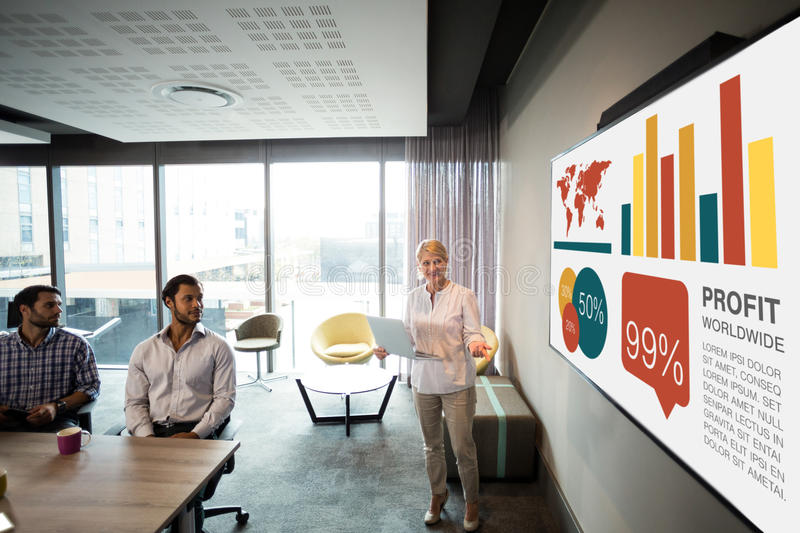 Composite image of graphic image of business presentation. Graphic image of business presentation against businesswoman giving presentation stock photo