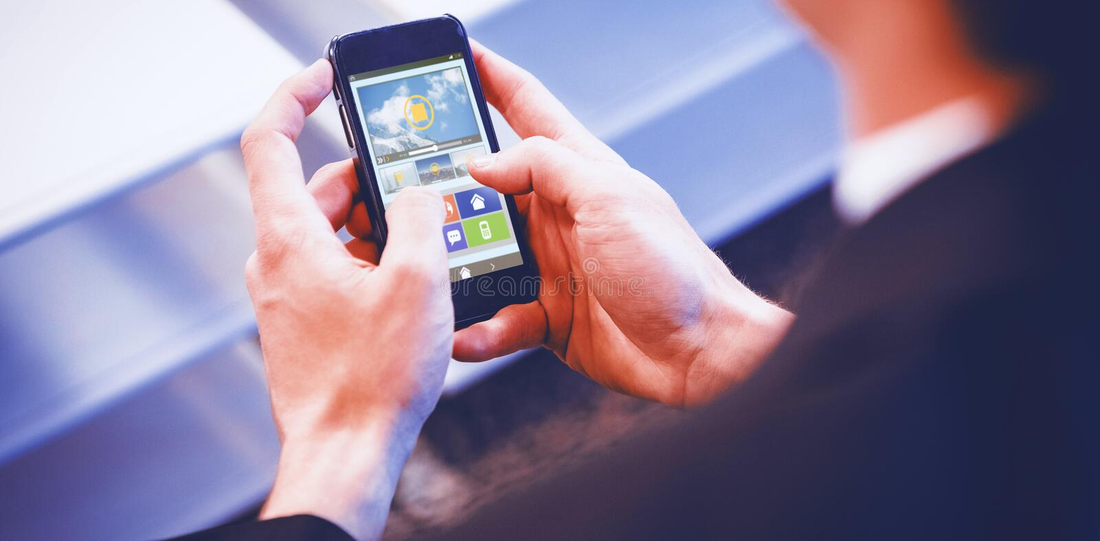 Composite image of graphic image of video player with various icons. Graphic image of video player with various icons against businessman touching smart phone royalty free stock photography