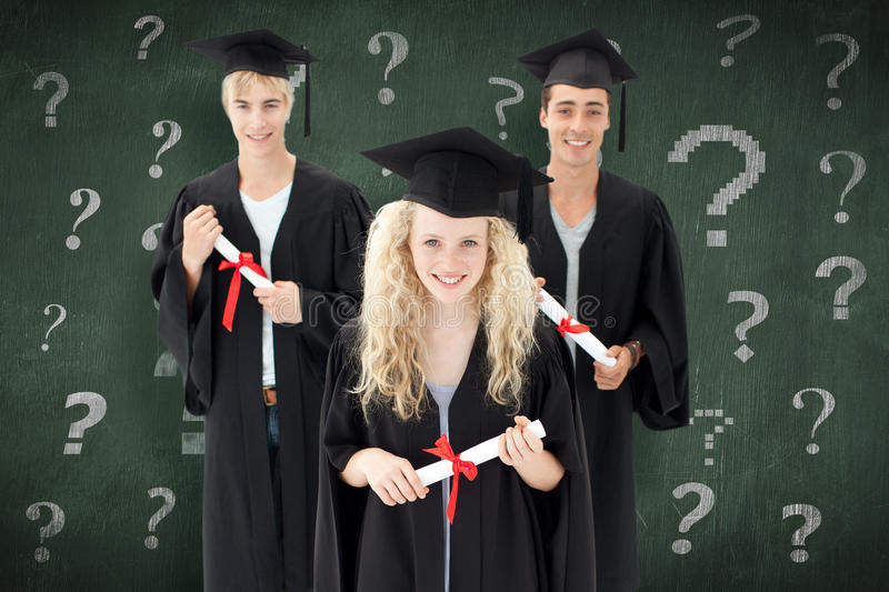 Composite image of group of adolescents celebrating after graduation. Group of adolescents celebrating after Graduation against green chalkboard royalty free stock image