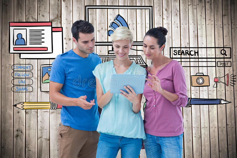 Composite image of group portrait of happy colleagues using tablet. Group portrait of happy colleagues using tablet against wooden planks background royalty free stock photography