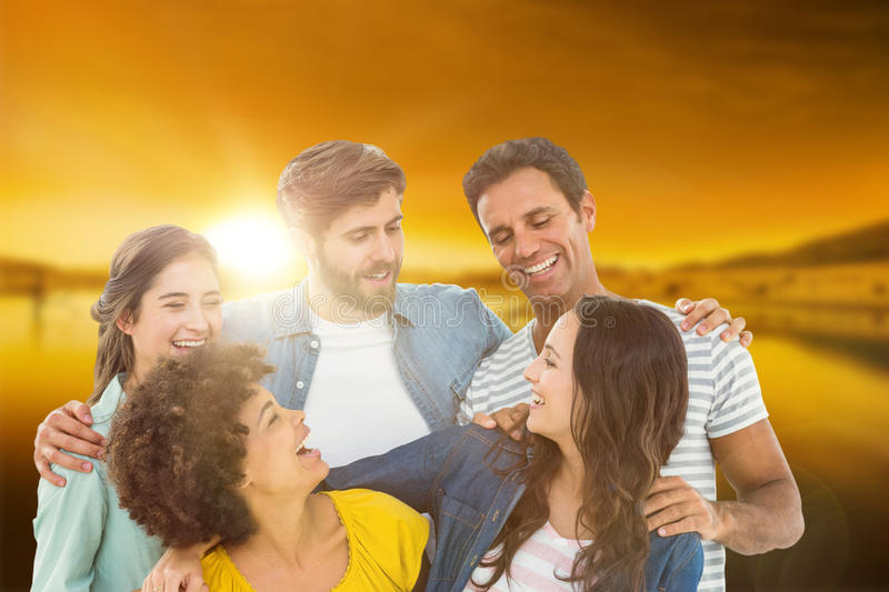 Composite image of group portrait of happy young colleagues. Group portrait of happy young colleagues against beautiful african scene royalty free stock photography