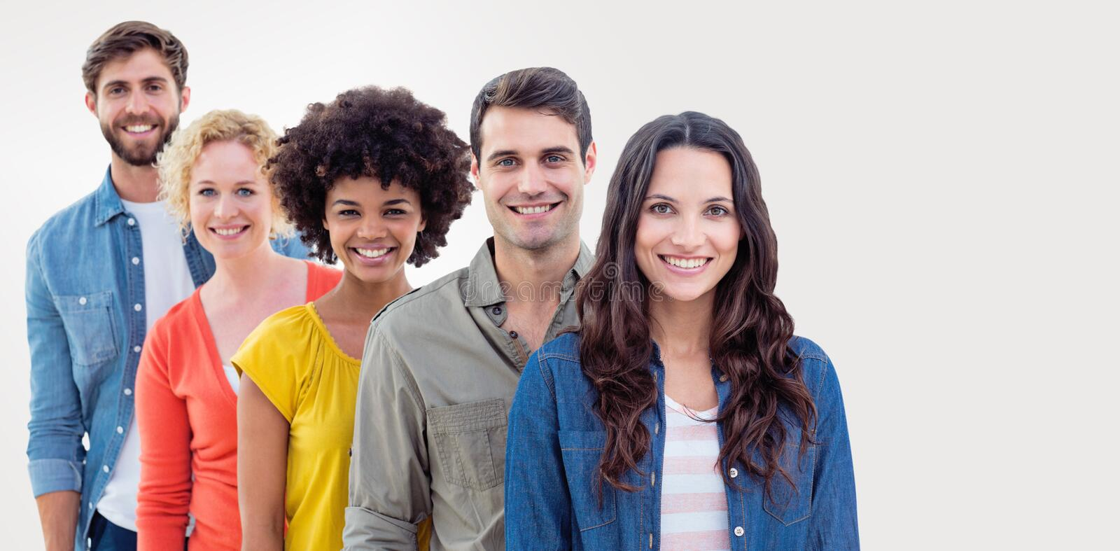 Composite image of group portrait of happy young colleagues. Group portrait of happy young colleagues against grey background royalty free stock photos