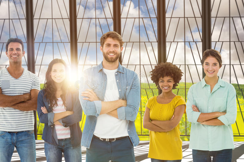 Composite image of group portrait of happy young colleagues. Group portrait of happy young colleagues against nature scene stock photos