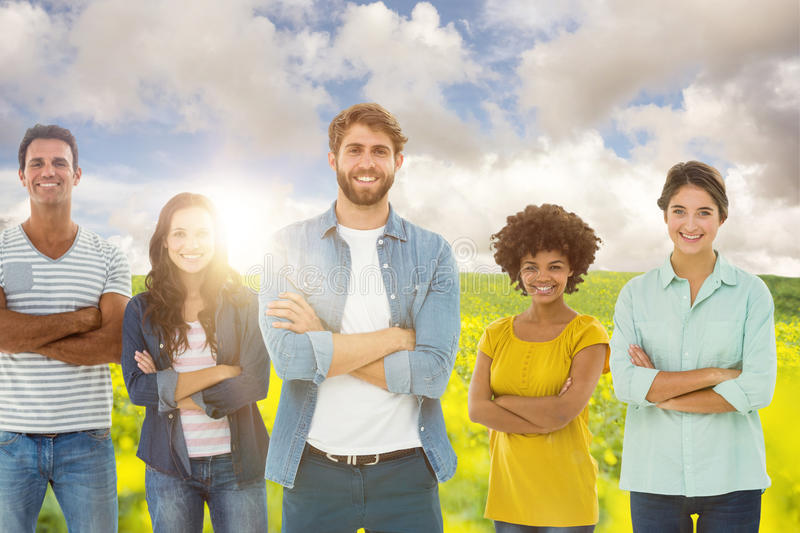 Composite image of group portrait of happy young colleagues. Group portrait of happy young colleagues against nature scene stock photo