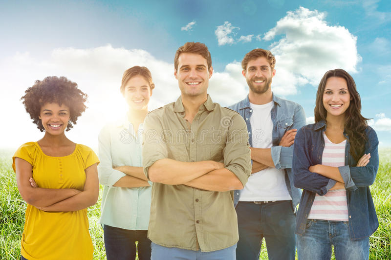 Composite image of group portrait of happy young colleagues. Group portrait of happy young colleagues against sunny landscape royalty free stock photography