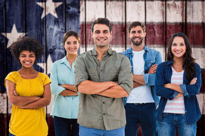 Composite image of group portrait of happy young colleagues. Group portrait of happy young colleagues against composite image of usa national flag royalty free stock photo