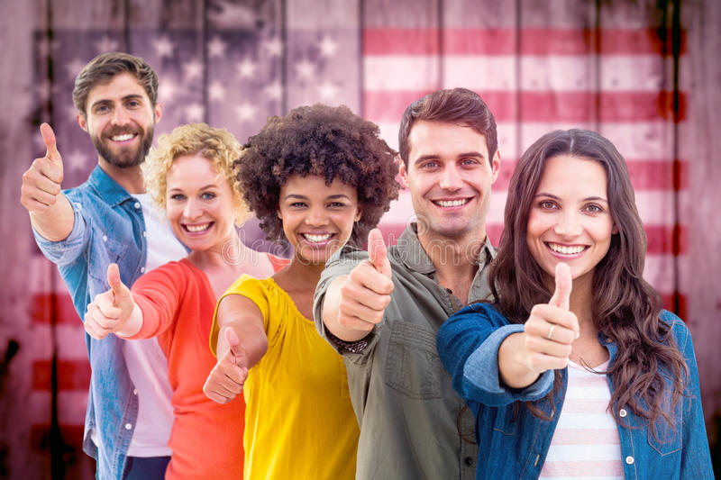 Composite image of group portrait of happy young colleagues. Group portrait of happy young colleagues against composite image of usa national flag stock photography