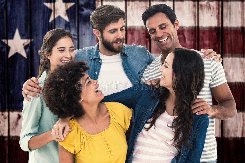 Composite image of group portrait of happy young colleagues. Group portrait of happy young colleagues against composite image of usa national flag royalty free stock images