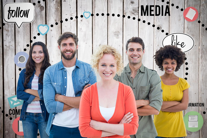 Composite image of group portrait of happy young colleagues. Group portrait of happy young colleagues against wooden planks royalty free stock image