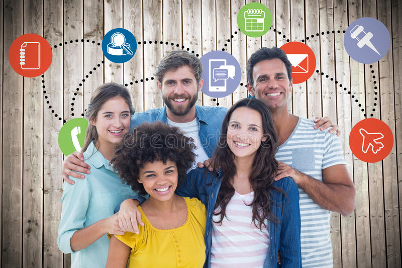 Composite image of group portrait of happy young colleagues. Group portrait of happy young colleagues against wooden planks background stock image