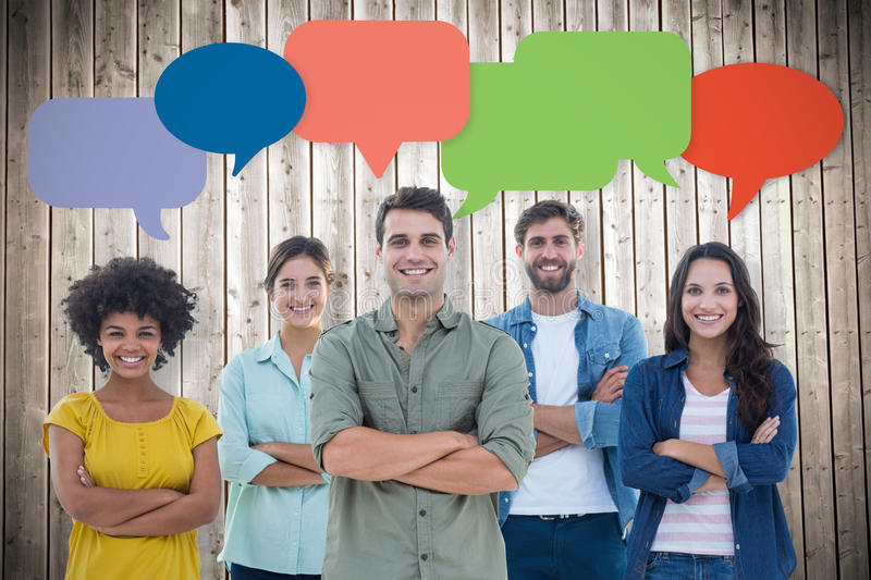 Composite image of group portrait of happy young colleagues. Group portrait of happy young colleagues against wooden planks background royalty free stock photography