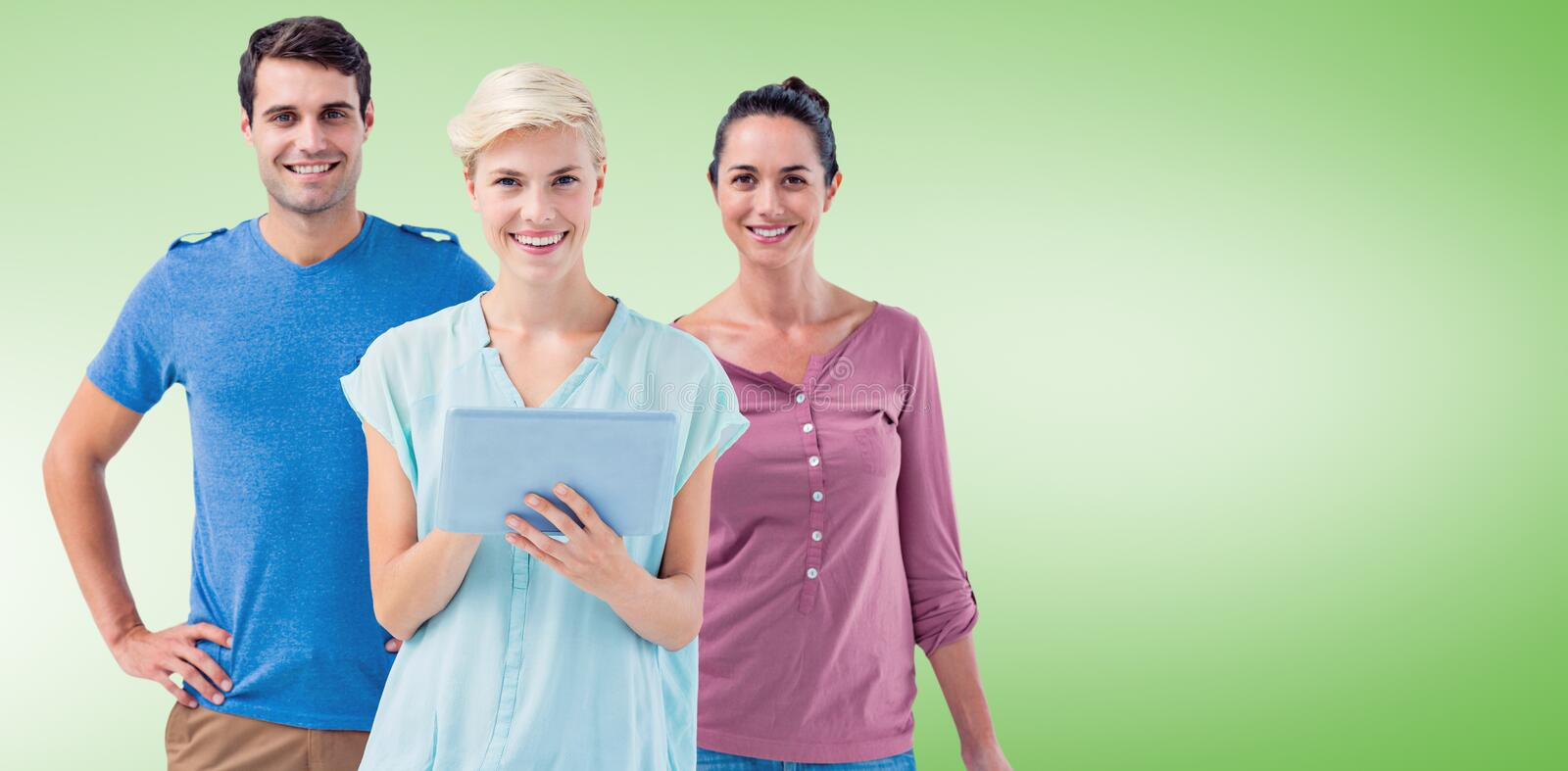 Composite image of group of three persons using tablet. Group of three persons using tablet against green vignette stock images