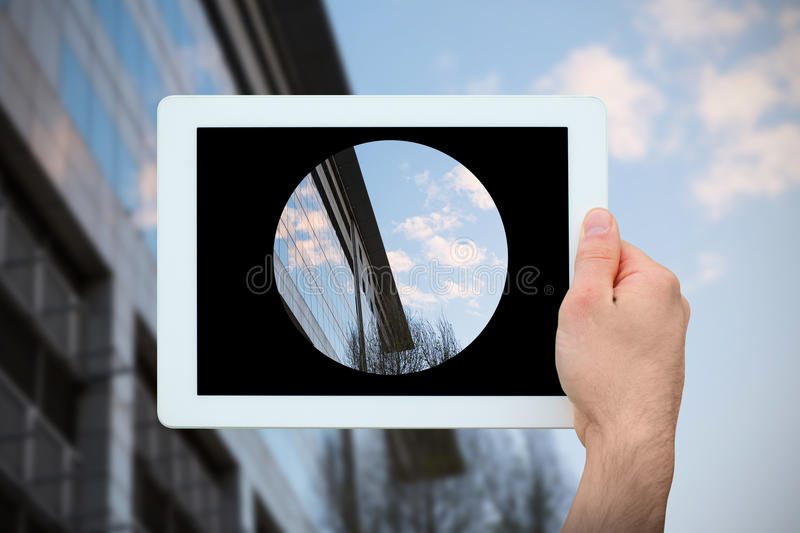 Composite image of hand holding tablet pc royalty free stock photography