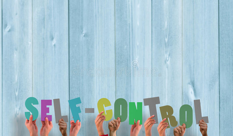 A Composite image of hands holding up self control stock photos