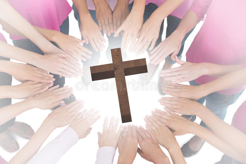 A Composite image of hands joined in circle wearing pink for breast cancer royalty free stock photos