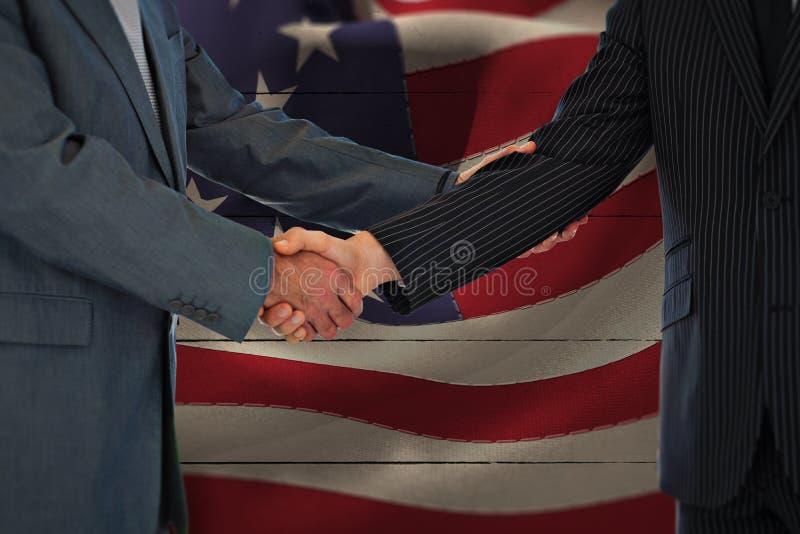 Composite image of handshake in agreement. Handshake in agreement against white wood stock image