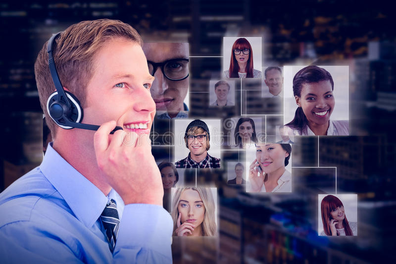 Composite image of handsome agent with headset royalty free stock image